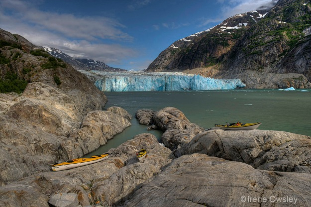 View of Dawes Glacier, Endicott Arm, with kayaks in the foreground.  Tracy Arm-Ford's Terror Wilderness, Tongass National Forest, Southeast Alaska